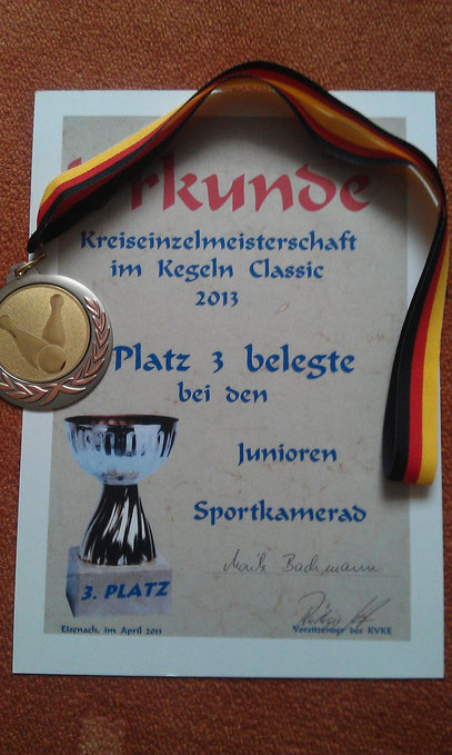 Urkunde und Medaille zur KEM 2013