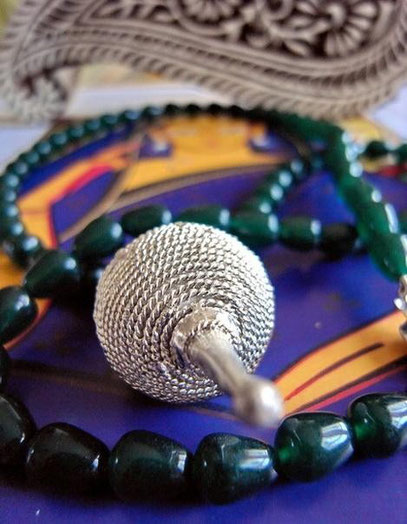Pagadi: dark-green, teardrop, jade necklace; close-up of sterling-silver-ball
