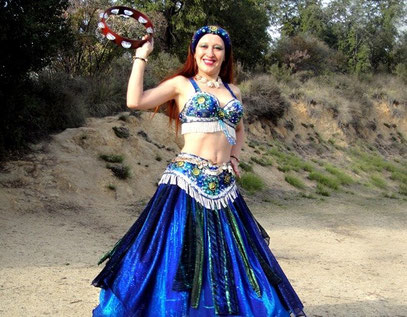 Sofia Metal Queen as Gypsy Sofia of Ameynra. Photo from video. bellydance with tambourine