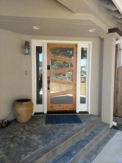 After new prefit fiberglass door staining, painting and installation