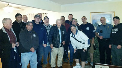 Members of the Fanwood Fire Department celebrate with Len Zuchowski