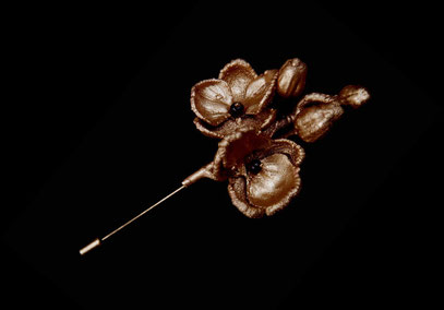 Orchid broach, gilded copper and garnets