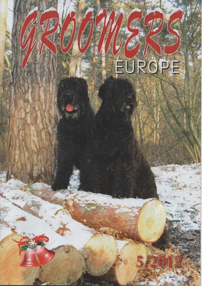 Zwarte Russische terriers Luka en Onyx op de cover van Groomers Europe