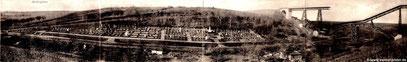 Panoramabild des Friedhofs und der zerstörten Brücke