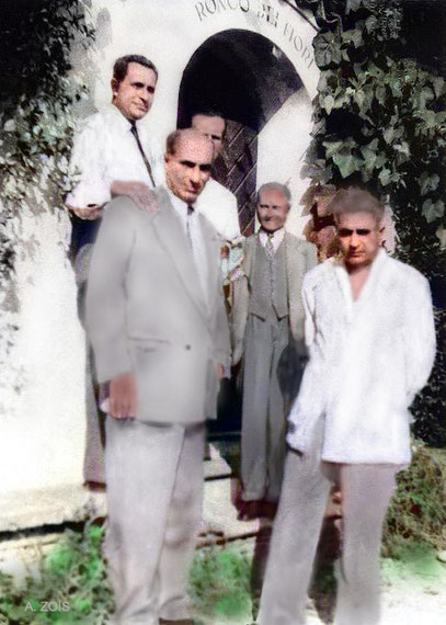 Some of the men mandali at the entrance of Hedi Merten's residency in Locarno, where some of them stayed. Image colourized by Anthony Zois.