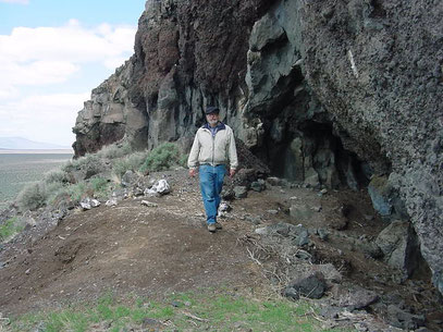 """Paisley Caves, above the Summer lake plain, Oregon. In these caves some of the oldest human remains in North America were found. Bill Cannon, archaeologist of the BLM Lakeview, district in the center.""  Photo from Wikimedia Commons."