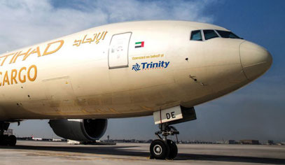 In appreciation of the partnership, EY Cargo has painted the Trinity logo on the hull of one of their B777 freighters  -  courtesy Trinity