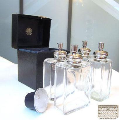 Moynat leather case with 4 bottles