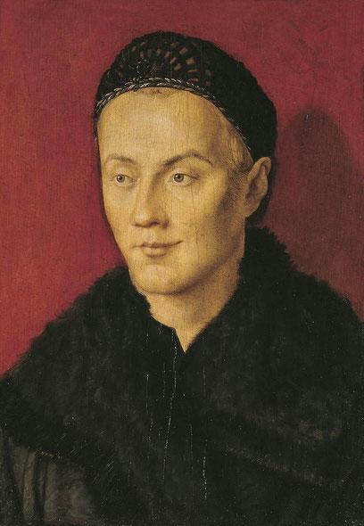 Retrato de un joven,atribuido a Durero.1500-10.Se pueden hacer conjeturas sobre la identidad,tal vez su hermano menor,aunque el jubón negro cerrado al cuello era típico de la burguesia al sur de Alemania.El rojo realza el rostro.Facciones y mirada íntima.