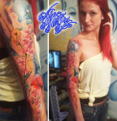 Watercolor flower sleeve. This sleeve is a memorial tribute to her grandmother as well  Genk Belgium tattoo shop watercolor text tattoo Blue Magic Pins tattoo Genk  Belgium aquarelle colorful pastel orchids poppy cherry blossoms
