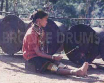 "Fig. 7. Playing a drum in a Kayah (unproperly said ""giraffe"") village nowadays."
