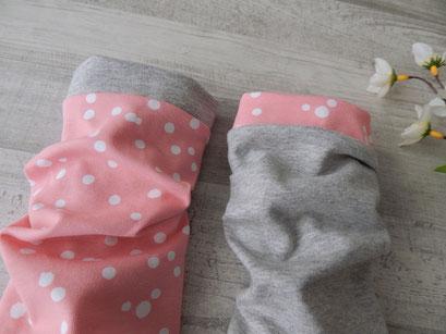 Detailfoto Armstulpen Dots rosa / weiß
