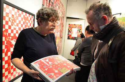 Jonathan shows me a book with his artwork. photo: Nicole Ponesch ©