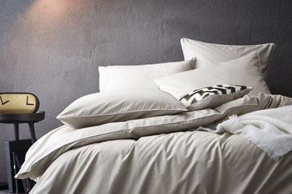 retouche sur linge de lit