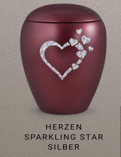 """Bespiel der Veredelungsmöglichkeit von Urnen -""""Sparkling Star"""" in gold, silber und schwarz glitzernd , je Motiv, je Namen oder je Datum 36,00 EUR extra + Urne"""