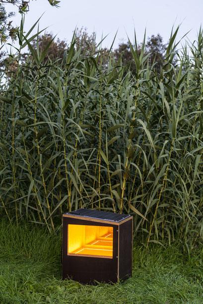 o.T. (I 07-2019) Wooden box, unidirectional mirrors, LED, solar panel, twilight switch, batteries, 65x51x51cm