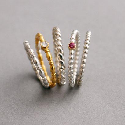 Kordelringe, 925er Sterlingsilber oder 750er Gelbgold mit Brillant oder Rubin