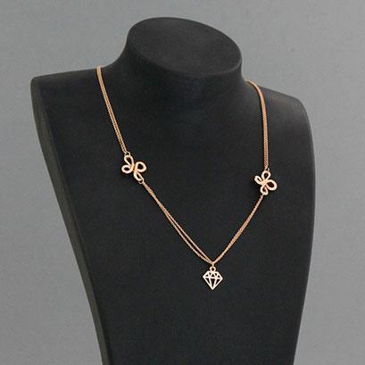 Halskette mit Brillantanhänger, Brillant als grafische Outline und 2 organische Zierteile, 585er Rotgold