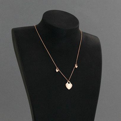 Halskette mit kleinem Herzanhänger und 2 kleinen Herzen, 585er Rotgold