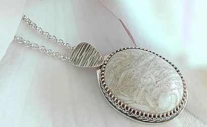 Stone from Petra set in silver and oxidised