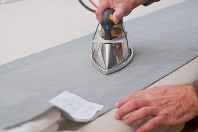mueden.de, Gardinenservice, BildBügeleisen Stoff bügeln