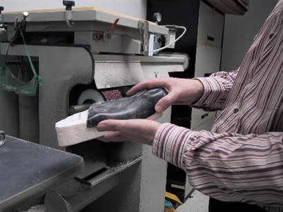 a custom orthotic after vacuum pressing to a cast