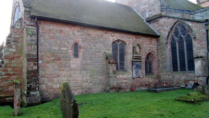 The chancel with its Norman window (left)