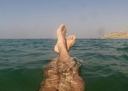 Floating in the dead sea, Jordan. Dante Harker
