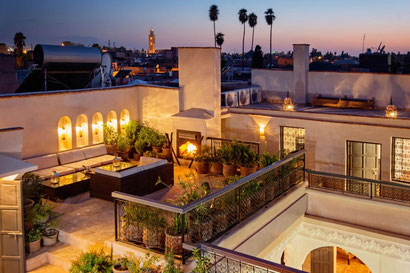 Riad Star's rooftop terrace at night