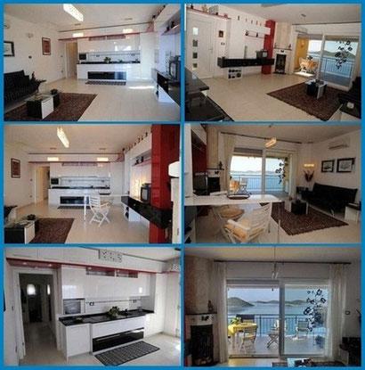 DeLuxe PENTHAUS PANORAMA***** - APARTMENT: Wohnzimmer mit klappbarem Esstisch und offener Küche