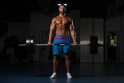 shoulder workout barbell shrugs