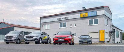 links Armin Mößler (Kfz Meister), rechts Rainer Mößler (Kfz Meister) von Auto Mößler Mühlhausen, Kfz-Meisterbetrieb / Opel-Service-Partner / Auto-Werkstatt für alle Marken und Modelle, Werkstatt für Nutzfahrzeuge