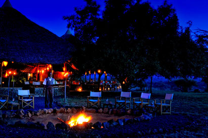 Fire at night, Severin Safari Camp, Tsavo National Park, Kenya. Dante Harker