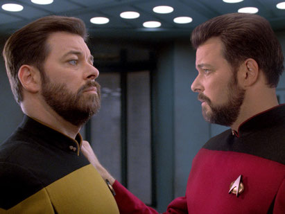 Image of two Rikers confronting each other from a Star Trek:  The Next Generation episode.  One of the Rikers is a result of a transporter accident.
