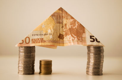 Geld- und Immobilien / Symboldarstellung