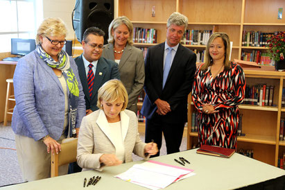 NJ Lt. Gov. Kim Guadagno signs the mandatory CPR instruction bill into law on August 20th, 2014