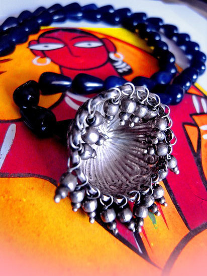 Gumbada necklace: close-up of underneath silver jhumka-earring, showing ball droplets