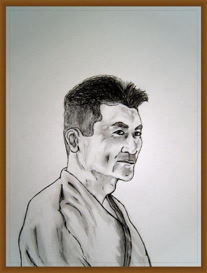 Eine Portrait-Zeichnung des SKAI Chief Instructors Shinji Akita. Ein Werk des Künstlers Erol Alp.