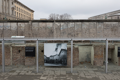 The photo shows the rest of the cellar of the former GESTAPO headquarters in Berlin. Right behind it there is a remnant of the Berlin Wall.