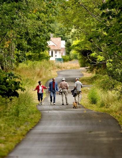 People meet on the Sheraton Greenway in Comox.
