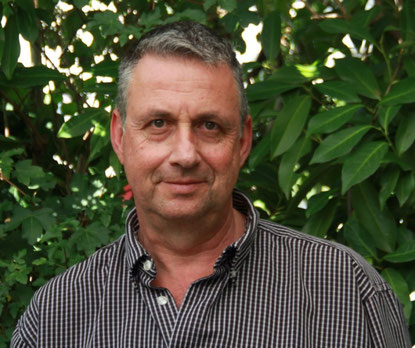 Profilbild von Lawrence Landolt. Wacher, direkter Blick aus braun, grünen Augen und ein freundliches Lächeln.