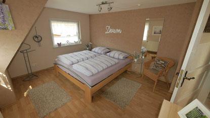 Schlafzimmer 1 Ferienhaus Siems-Müller