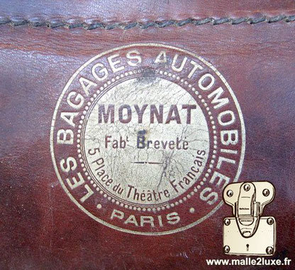 logo ancienne moynat malle automobile bagage