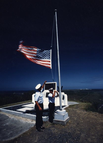 29 September, 1993:  after a continuous 48-year presence on the island, US Coastguardsmen lower the US flag for the last time atop Mt Suribachi, Iwo Jima, Japan.
