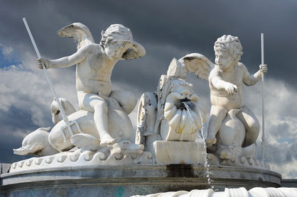 A set of marble sculptures, which shows little angels playing with farming tools and water.