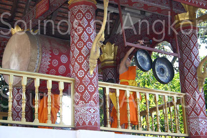 Drum set and pair of bossed gongs in the communication tower of a Buddhist monastery. Luang Prabang, Laos.