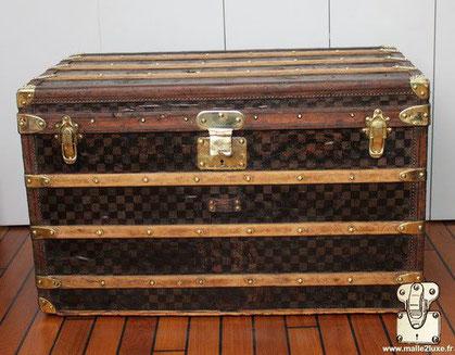 Louis Vuitton Courier trunk - Damier Year: Around 1890  Exterior: Dark Mark 1 Stenciled Checkerboard Canvas  Trim: leather