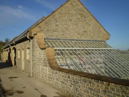 Stone stables with adjoining glasshouse