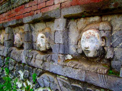 masks in a temple-wall
