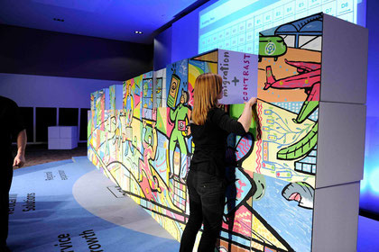 instead of a sudden unveiling the participants see the final wall of art  grow together